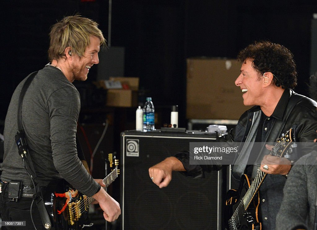 Joe Don Rooney of Rascal Flatts and Neal Schon of Journey perform during CMT Crossroads: Journey and Rascal Flatts Live from Super Bowl XLVII rehearsals on February 1, 2013 in New Orleans, Louisiana.