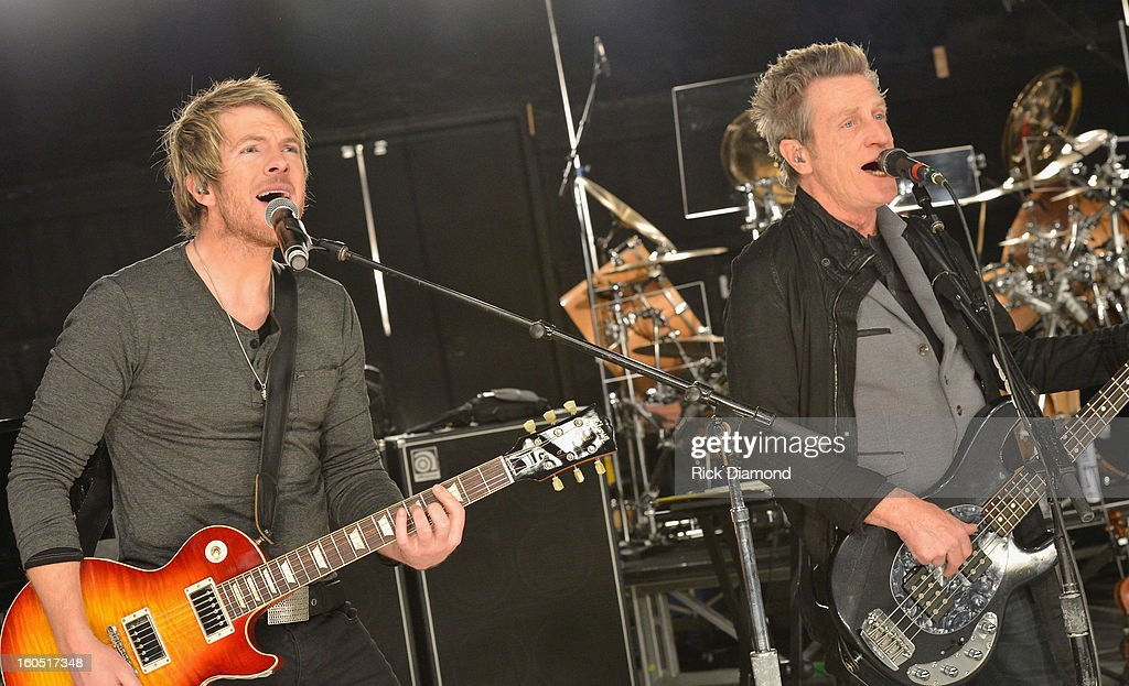 Joe Don Rooney of Rascal Flatts and Ross Valory of Journey perform during CMT Crossroads: Journey and Rascal Flatts Live from Super Bowl XLVII rehearsals on February 1, 2013 in New Orleans, Louisiana.