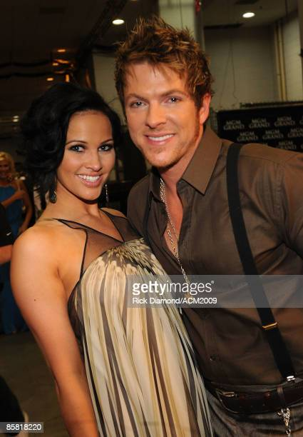 Joe Don Rooney of Rascal Flatts and wife Tiffany Fallon pose backstage during the 44th annual Academy Of Country Music Awards held at the MGM Grand...