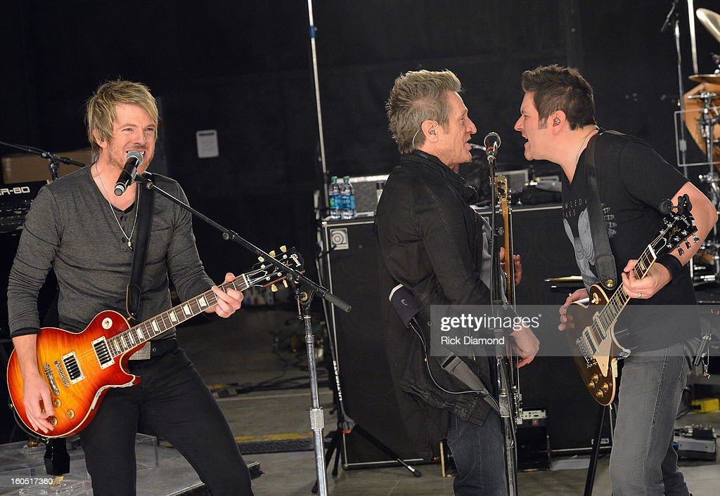 Joe Don Rooney, Ross Valory and Jay DeMarcus perform during CMT Crossroads: Journey and Rascal Flatts Live from Super Bowl XLVII rehearsals on February 1, 2013 in New Orleans, Louisiana.
