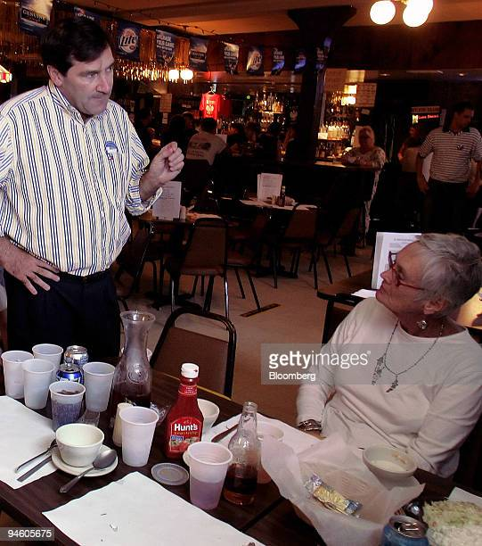 Joe Donnelly a Democratic candidate for the US House of Representatives left talks with Barbara Antonietti at a fish fry campaign event in Michigan...
