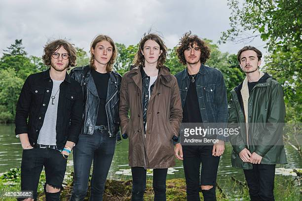 Joe Donovan Myles Kellock Tom Ogden Charlie Salt and Josh Dewhurst of Blossoms pose by the lake at Kendal Calling Festival on July 31 2015 in Kendal...