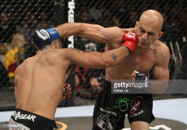 Joe Duarte punches Saad Awad during a lightweight bout at the Strikeforce event at the Valley View Casino Center on April 9, 2011 in San Diego,...
