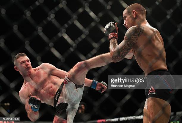 Joe Duffy of Ireland kicks Dustin Poirier in their lightweight bout during the UFC 195 event inside MGM Grand Garden Arena on January 2, 2016 in Las...