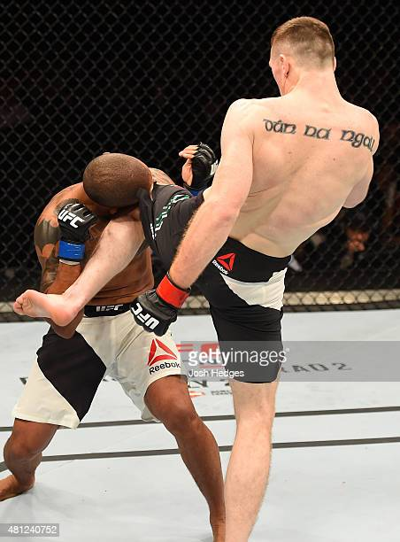 Joe Duffy of Ireland knees Ivan Jorge of Brazil in their lightweight fight during the UFC Fight Night event inside the SSE Hydro on July 18 2015 in...