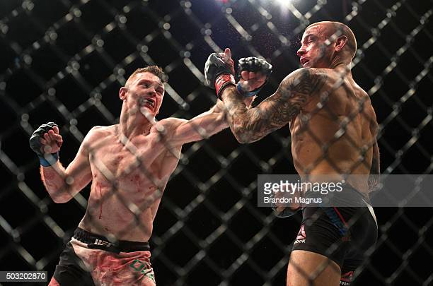 Joe Duffy of Ireland punches Dustin Poirier in their lightweight bout during the UFC 195 event inside MGM Grand Garden Arena on January 2, 2016 in...