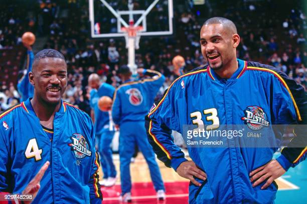 Joe Dumars and Grant Hill of the Detroit Pistons laugh circa 1997 at the Compaq Center in Houston Texas NOTE TO USER User expressly acknowledges and...