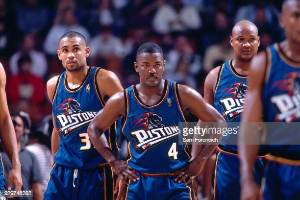 Joe Dumars and Grant Hill of the Detroit Pistons look on circa 1997 at the Compaq Center in Houston Texas NOTE TO USER User expressly acknowledges...