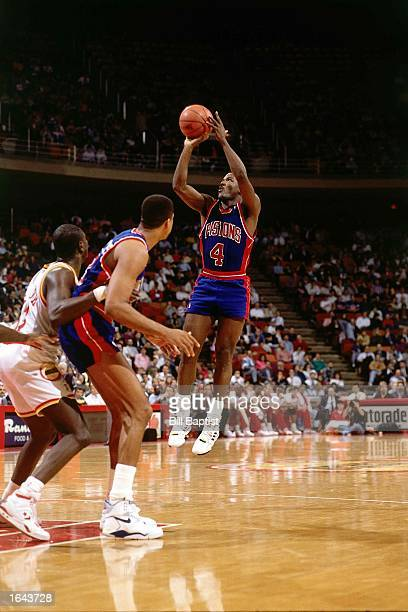 Joe Dumars of the Detroit Pistons shoots a jump shot during the 1990 NBA game against the Houston Rockets at the Summit in Houston Texas NOTE TO USER...