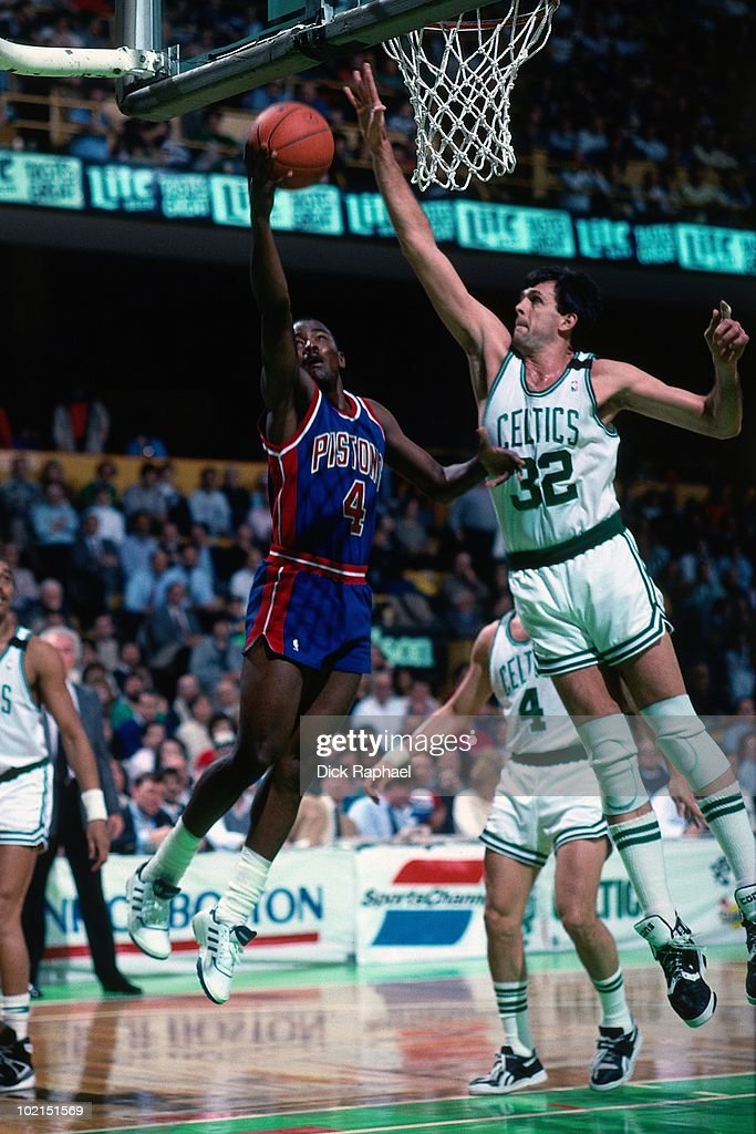 Joe Dumars #4 of the Detroit Pistons shoots a layup against Kevin McHale #32 of the Boston Celtics during a game played in 1990 at the Boston Garden in Boston, Massachusetts.
