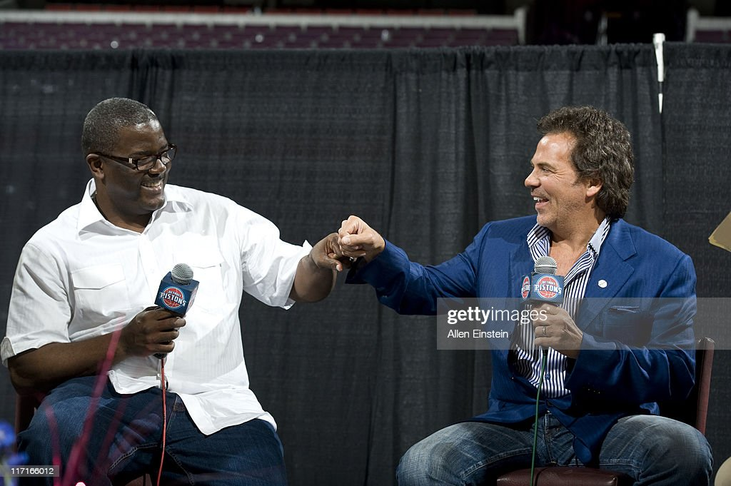 Joe Dumars, President of the Detroit Pistons and Tom Gores, Owner of the Detroit Pistons 'fist bump' to show their excitement during the Detroit Pistons Draft Night Party at the Palace of Auburn Hills on June 23, 2011 in Auburn Hills, Michigan.