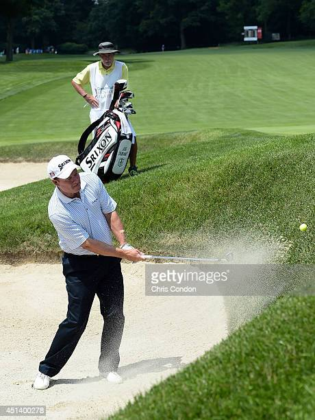 Joe Durant plays from a bunker on the 10th hole during the third round of the Constellation SENIOR PLAYERS Championship at Fox Chapel Golf Club on...
