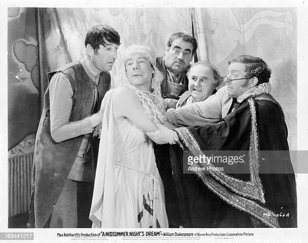 Joe E Brown being grabbed by group men in a scene from the film 'A Midsummer Night's Dream' 1935