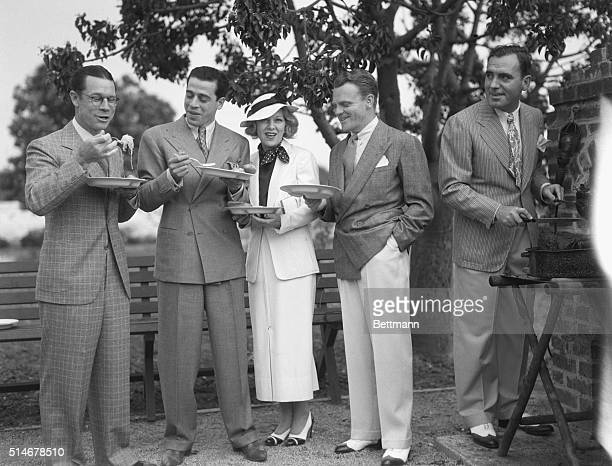 Joe E Brown Fred Keating Glenda Farrell James Cagney and Pat O'Brien gather together for a barbecue on June 4 1935 The film stars are at the home of...