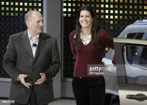 Joe Eberhardt Chrysler Group Executive vice president of Global Sales and Marketing jokes with actress Angie Harmon during a skit to introduce the...