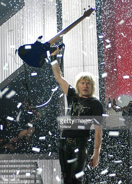 Joe Elliot of Def Leppard performs Pour Some Sugar on Me