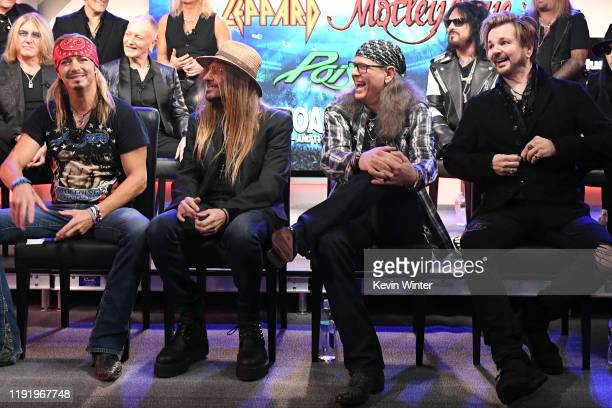 Joe Elliott and Phil Collen of Def Leppard Nikki Sixx of Mötley Crüe and Bret Michaels CC DeVille Bobby Dall and Rikki Rockett of Poison attend the...