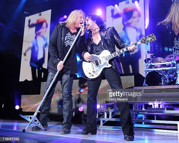 Joe Elliott and Vivian Campbell of Def Leppard perform on opening night of their US tour at Cruzan Amphitheatre on June 15, 2011 in West Palm Beach,...