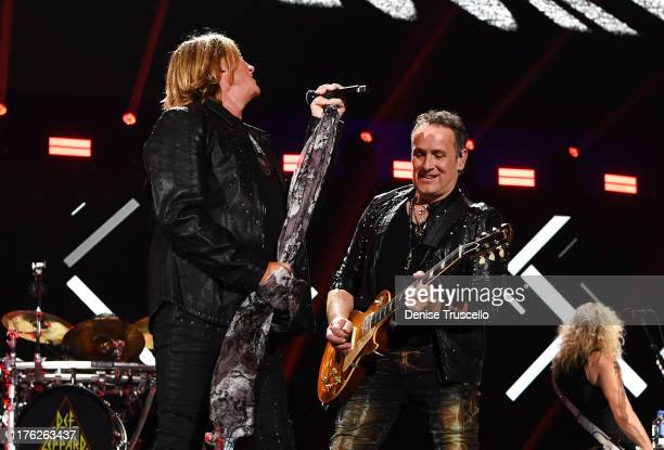 Joe Elliott and Vivian Campbell of Def Leppard perform onstage during the 2019 iHeartRadio Music Festival at T-Mobile Arena on September 21, 2019 in...