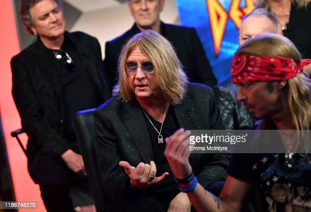 Joe Elliott of Def Leppard and Bret Michaels of Poison speak during the press conference for THE STADIUM TOUR DEF LEPPARD MOTLEY CRUE POISON at...