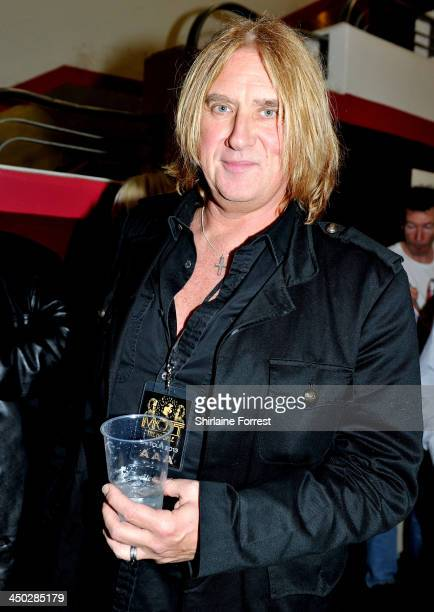 Joe Elliott of Def Leppard attends Mott The Hoople performing on stage at Apollo on November 17, 2013 in Manchester, United Kingdom.
