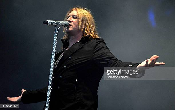 Joe Elliott of Def Leppard performs on day one of the Download Festival at Donington Park on June 10 2011 in Castle Donington England