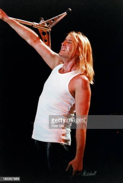 Joe Elliott of Def Leppard performs on stage at the Birmingham NEC on October 16th 1996 in Birmingham England