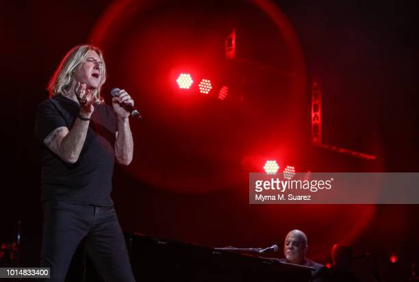 Joe Elliott of Def Leppard performs Pour Some Sugar On Me with Billy Joel at Fenway Park in Boston Massachusetts Billy Joel is the first artist to...