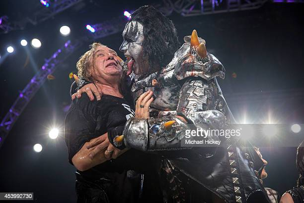 Joe Elliott of Def Leppard reacts as Gene Simmons of KISS leans in to lick his face after they performed the ALS Ice Bucket Challenge at Klipsch...