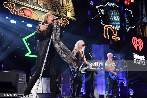 Joe Elliott Rick Savage and Phil Collen of Def Leppard perform onstage during the 2019 iHeartRadio Music Festival at TMobile Arena on September 21...