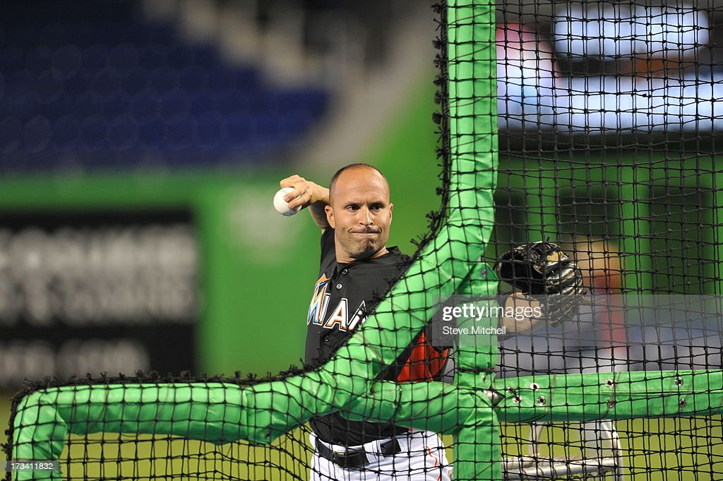 Joe Espada #4 of the Miami Marlins throws out pitches during batting practice prior to a game against the Washington Nationals at Marlins Park on July 13, 2013 in Miami, Florida.