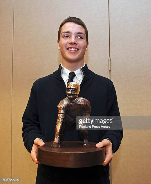 Joe Esposito of Portland High School is awarded the 45th James J Fitzpatrick trophy during a ceremony at Holiday Inn by the Bay in Portland