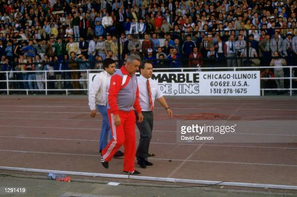 Joe Fagan Manager of Liverpool walks along the track towards the pitch before the European Cup Final against Juventus at the Heysel Stadium in...