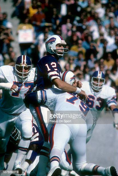Joe Ferguson of the Buffalo Bills gets his pass off before getting hit by Barney Chavous of the Denver Broncos during an NFL football game at Rich...