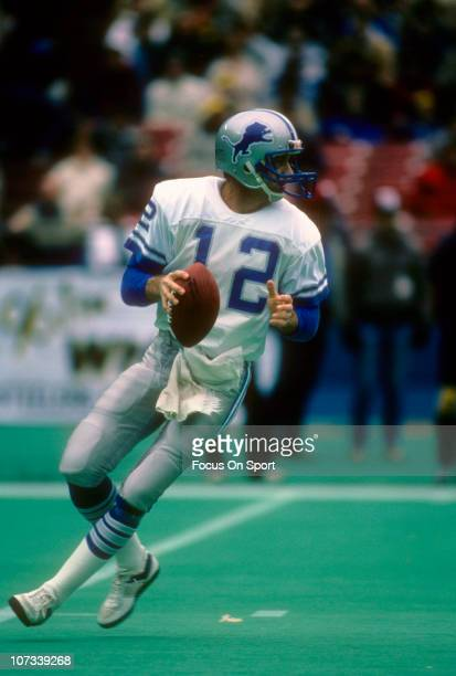 Joe Ferguson of the Detroit Lions drops back to pass against the Pittsburgh Steelers during an NFL football game at Three Rivers Stadium December 7...