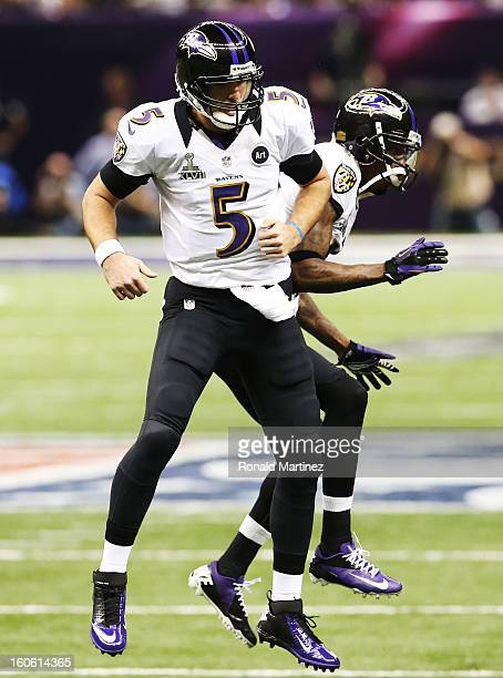 Joe Flacco and Jacoby Jones of the Baltimore Ravens celebrate after Flacco threw a 1 yard touchdown pass to Dennis Pitta in the second quarter...