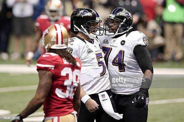 Joe Flacco and Michael Oher of the Baltimore Ravens celebrate after Flacco threw a 13yard touchdown pass to Anquan Boldin in the first quarter...