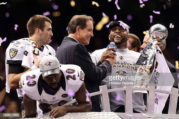 Joe Flacco Ed Reed and Ray Lewis of the Baltimore Ravens celebrate with the VInce Lombardi trophy after the Ravens won 3431 against the San Francisco...