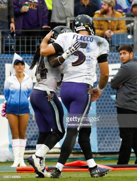 Joe Flacco of the Baltimore Ravens and Alex Collins embrace during the third quarter against the Tennessee Titans at Nissan Stadium on October 14...