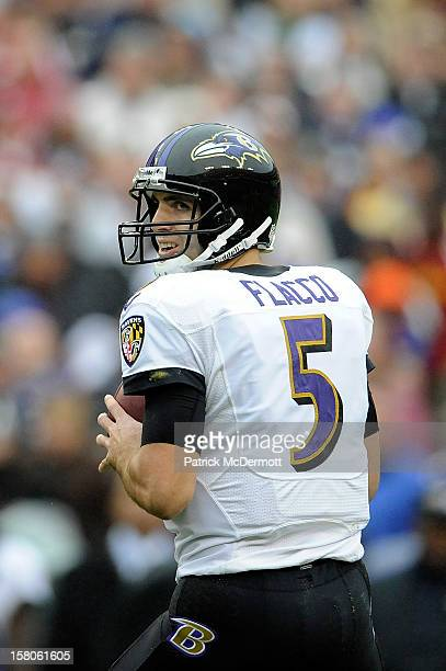 Joe Flacco of the Baltimore Ravens drops back to make a pass against the Washington Redskins during a game at FedExField on December 9 2012 in...