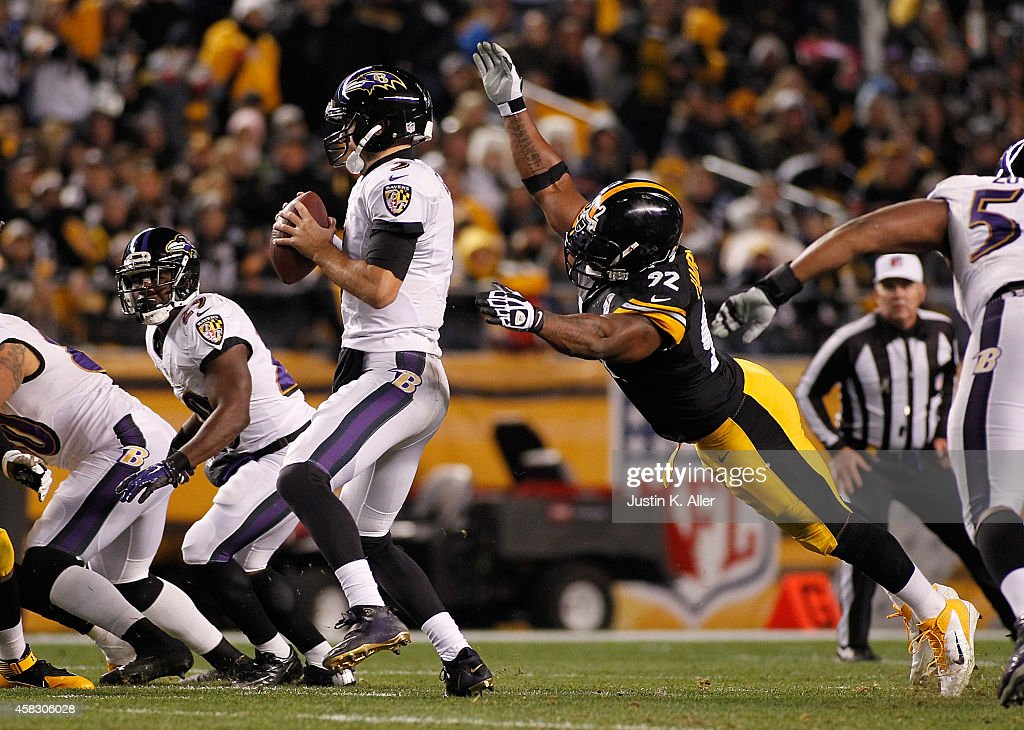 d3020075dfc Joe Flacco of the Baltimore Ravens is sacked by James Harrison of ...