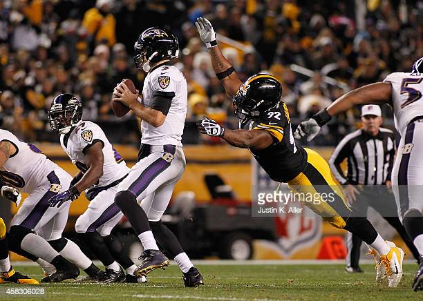 Joe Flacco of the Baltimore Ravens is sacked by James Harrison of the Pittsburgh Steelers during the first quarter at Heinz Field on November 2 2014...