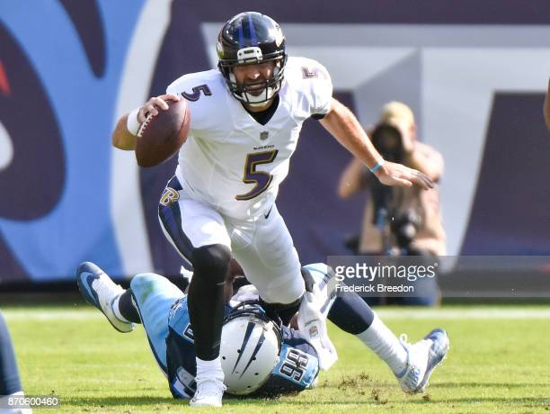 Joe Flacco of the Baltimore Ravens is sacked by Jurrell Casey of the Tennessee Titans during the first half at Nissan Stadium on November 5, 2017 in...