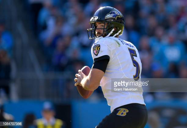 Joe Flacco of the Baltimore Ravens looks to pass against the Carolina Panthers during their game at Bank of America Stadium on October 28 2018 in...