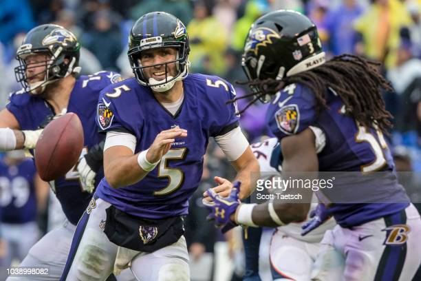 Joe Flacco of the Baltimore Ravens pitches to Alex Collins as Derek Wolfe of the Denver Broncos pursues during the second half at MT Bank Stadium on...