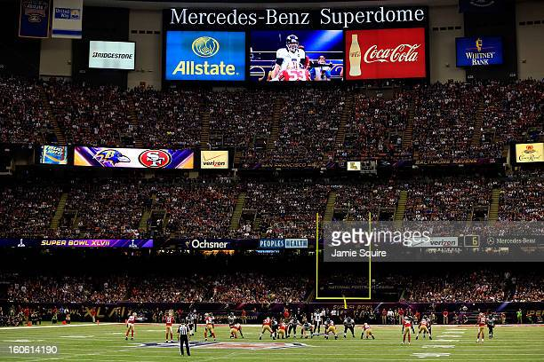 Joe Flacco of the Baltimore Ravens stands behind center against the San Francisco 49ers in the first quarter during Super Bowl XLVII at the...