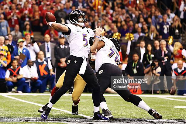Joe Flacco of the Baltimore Ravens throws a 13yard otuchdown pass in the first quarter against the San Francisco 49ers during Super Bowl XLVII at the...