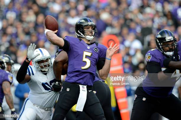 Joe Flacco of the Baltimore Ravens throws a pass in the first half against the Indianapolis Colts during the AFC Wild Card Playoff Game at MT Bank...