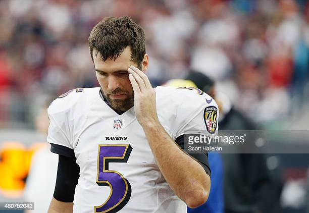 Joe Flacco of the Baltimore Ravens waits nera the bench during their game against the Houston Texans at NRG Stadium on December 21 2014 in Houston...