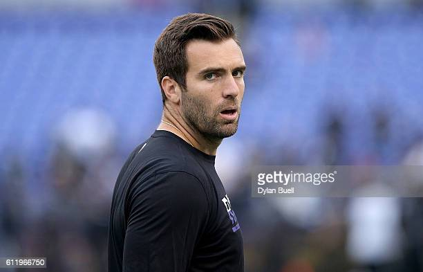 Joe Flacco of the Baltimore Ravens walks across the field before the game against the Oakland Raiders at MT Bank Stadium on October 2 2016 in...
